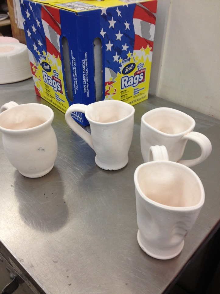 My group of bisque fired cups ready to glaze