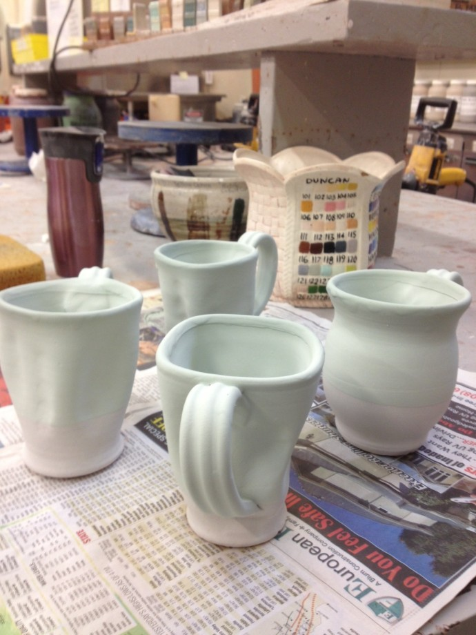 Glazed cups now ready for the second firing.